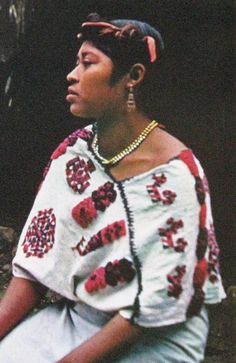 This photo comes from an out of print book on Mexican folk art that was published in 1971. The woman in the photo is a Nahua from the region of San Pedro Coyutla in the state of Veracruz Mexico. She is wearing a kind of prehispanic cape known as a quechquemitl