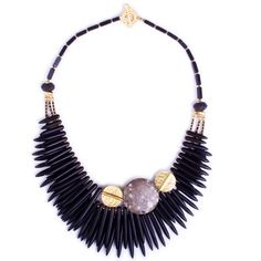 Check out the gorgeous Pure Charcoal Spike and Gold Ingenuity Statement Necklace at Luka. It is a trio of spikes made from Howlite, with Lava beads and fossilised Sea Lilies from different parts of the world. It also features 16 and 22 karat gold parts.