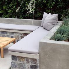 Built in Bench Seating with Cushion.  Loon Lake Stone Veneer and Smooth Stucco Finish.