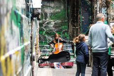 https://flic.kr/p/FFjCV5 | The cello | Musician sitting in a laneway, not far from Flinders street station. She plays cello, and people listen to her music.  I love the look she gives to her audience...