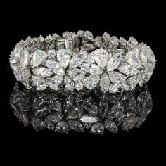 HARRY WINSTON, New York, c1970, Marquise, pear & round diamond Abstract bracelet.