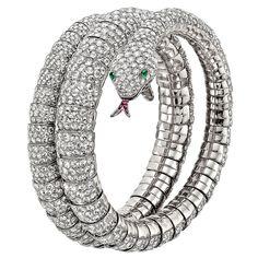 Pave Diamond Gold Snake Wrap Bracelet | From a unique collection of vintage cuff bracelets at https://www.1stdibs.com/jewelry/bracelets/cuff-bracelets/