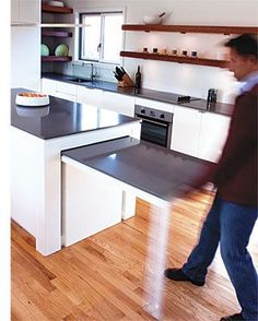 Hideaway Kitchen Table, great idea for condos with limited, open living and kitchen spaces for those w