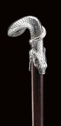 Cane with silver handle shaped as a snake. The handle is stamped Lalique, overstamped with makers mark of Artel and Kokoschnik for Moscow century.