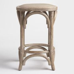 With a matte twill-weave rattan seat and rope binding accents, our classic wood counter stool features a dark gray beech finish for a rustic look.