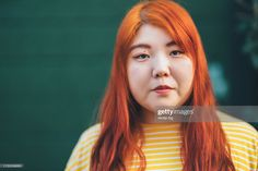 Stock Photo : Portrait of millennial generation young woman wearing yellow t-shirt in front of green wall Millennial Generation, Yellow T Shirt, Lightbulb, Rough Cut, Still Image, Young Women, Royalty Free Images, Dyed Hair, Presentation