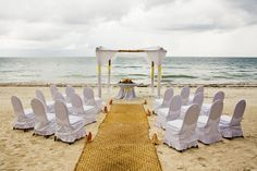 Simple decor for a beach front ceremony with up to 150 guests allows for breathtaking, uninterrupted views of the ocean. #dreamsrivieracancun