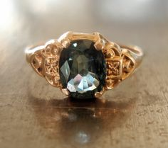 Antique Two-Tone Sapphire Ring in Art Deco Setting   (2 h a n d engraved flowers to complement the center stone)