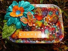 colorful altered tin
