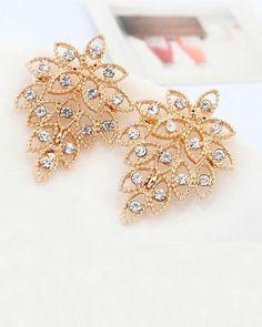 Accentuate your femininity wearing these Rhinestone Stud earrings -https://www.cooliyo.com/product/96852/dazzling-gold-leaf-designer-stud-earrings/