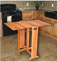 The Wooden Folding Table is a hardwood dining room table with collapsible sides for easy storage. Table leaves can be raised individually to fit your needs