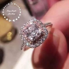 Very statement and feminine engagement ring with a romance pink diamond halo! So sparkly!!! See a video of this ring at: https://www.instagram.com/p/BaRHtNGnaq_/ Hand made 2-carat eq. Cushion cut diamond simulant engagement ring, with pink and white diamond simulant double halo
