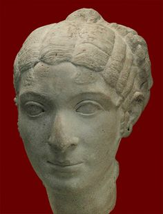 Portrait head in marble of a woman with a hair arrangement of the late Republican period. Said to be one of the ladies of Cleopatra VII's court who went with her to Rome in 46 BCE. Italy 80-40 BCE.London, British Museum.