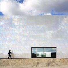 Music Hall and House in Algueña (in a village near Alicante) by Cor & Asociados | Shimmering porcelain tiles clad the auditorium