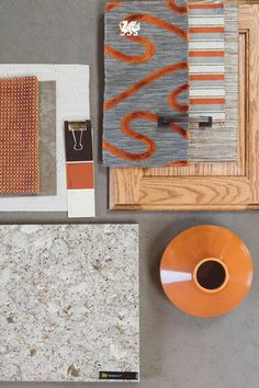 Designing around oak cabinetry? Our Berkeley™ design balances vivid orange accents with glimmers of copper, bronze and rich browns. // Designed by: @Studio M Interiors