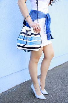 An Dyer wearing Call it Spring Light Blue Pumps with Brahmin Blue Stripe Bucket Bag @hautepinkpretty waysify
