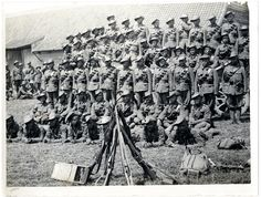 Group of 2/2 Gurkhas, who have returned to duty after being wounded [near Merville, France]. Photographer: H. D. Girdwood.  Reference: Photo 24/(139)   From the Girdwood Collection held by the British Library. This image is part of the Europeana Collections 1914-1918   Date: 26 Jul 1915.