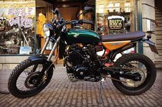 One day I hope to make a pilgrimage to Amsterdam's @rustygoldmotorshop. Loving this NX650 they have on display. For sale! #honda #nx650 #scrambler #dualsport #britishracinggreen