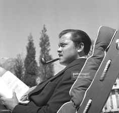 Actor, director and writer Orson Welles works on a script circa 1940...
