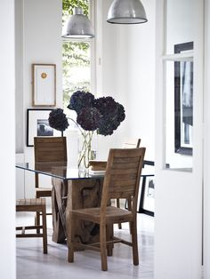 Teak Root Glass Dining Table with Oasis Dining Chairs both in natural teak.