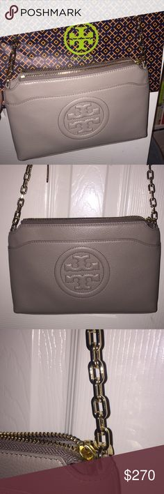 Tory Burch Crossbody Cute Crossbody gold chain detailing purse! Only been used twice! It's practically brand new. Didn't want it anymore since I bought another Tory Burch one just today. There's a magnetic closure compartment on the outside and inside compartments are as shown within the pictures. Very very cute beige color! :) Tory Burch Bags Crossbody Bags