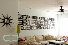 black and white photo gallery in living room