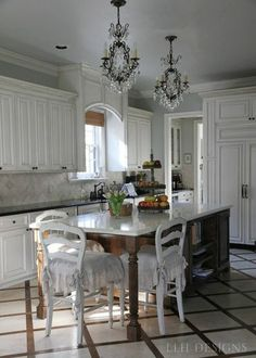 """built in cornice over the window. slipcover. """"both the kitchen and my studio are manchester gray from pratt & lambert."""" LLH Design..."""