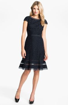 """The sumptuous silhouette of a rich lace dress is nipped at the waist by tonal ribbon. Sheer eyelet details trim the cap-sleeve bodice and flared hem. Approx. length from shoulder to hem: regular 40""""; petite 37 1/4"""". Measurements taken from sizes 8 and 8P; may vary slightly by size. Hidden back-zip closure. Removable belt. Fully lined. Cotton/nylon; dry clean."""