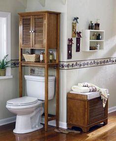 "Over-the-toilet storage from ""Maximizing Bathroom Storage"" Bathroom Storage Over Toilet, Small Bathroom Sinks, Bathroom Design Small, Simple Bathroom, Bathroom Shelves, Bathroom Designs, Storage Design, Storage Ideas, Easy Storage"