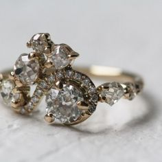 Love this if you used your grandma's diamond and my grandma's opal and then small diamonds to make it interesting like this