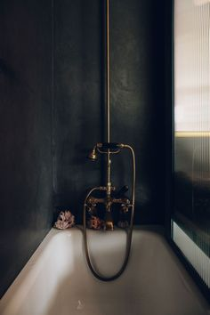 black and brass bath