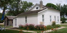 """De Smet bills itself as """"The Little Town on the Prairie,"""" and with good reason — Laura Ingalls Wilder reminisced about childhood memories spent here in some of her most famous works. The Surveyor's House was the first home her family lived in in De Smet in 1879, and it was quite large by Laura's standards. """"Laura thought that there must have been a great many surveyors to need so much space. This would be by far the largest house she had ever lived in,"""" she wrote in her autobiographical…"""