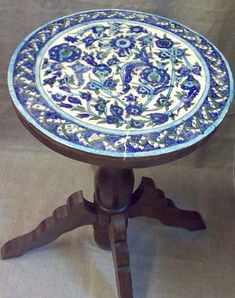 Iznik Tile -Top Table, antique. Handcrafted circular bedside table topped with beautiful Syrian iznik tiles atop a single pillar with four curved legs.