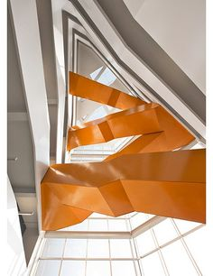 Designed by Saucier + Perrotte Architectes, this orange staircase zigzags across all six floors of the Anne-Marie Edward Science Building at John Abbott College near Montreal.