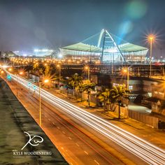 This is a view of my amazing hometown- Durban, South Africa. A light trail from the city center was done by having a slow shutter and it leads to the moses Mabhida stadium which dominates the skyline in Durban. Landscape Photography, Art Photography, Durban South Africa, Slow Shutter, Family Photos, Couple Photos, Light Trails, Corporate Events, Skyline