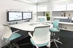 telepresence | Steelcase coloured chairs add vibrancy to an office with simple/dull furniture and colours