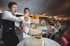 Funny cake-cutting moment at reception, by The Rasers.  Wedding in Wildwood, MO.