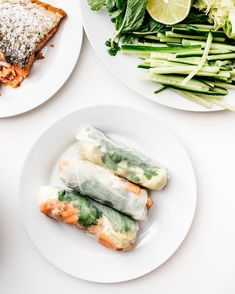 summer rolling  chewy fresh rice paper wrappers filled with crispy skin on salmon cucumbers butter lettuce and all the herbs. not pictured a giant bowl of jalapeño fish sauce to dip!