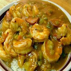 Shrimp Capri...  1 pound large shrimp 2 cups chopped tomatoes or fresh tomato sauce 1/2 cup white wine 2 tablespoons capers 2 cloves garlic, minced Dash of red pepper flakes (optional) 12 black olives, pitted and coarsely chopped 3 tablespoons olive oil 1/4 cup fresh parsley, chopped 2 tablespoons butter Salt and black pepper
