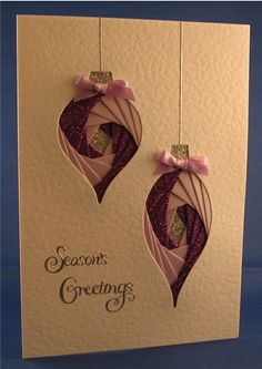 handmade Christmas card ... two baubles with pink and purple iris folding ... luv the glitter paper and shimmery look ... beautiful precision!!
