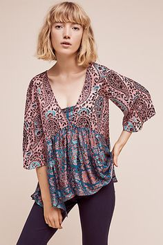 Viscose, silk Pullover styling A great blouse you can dress it up or wear it with your favorite jeans.