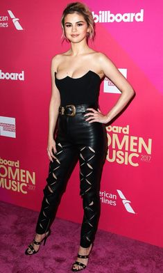 Selena Gomez in a black bustier top and cutout leather pants
