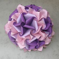 Twirligami - Beautiful curves deviate from traditional origami