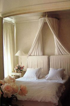 a nicely done bed...good for anyone who loves to have a bed canopy but doesn't want the hassle of if being all around the bed