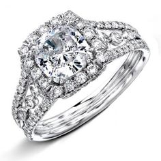 "NATALIA - There might be many ways to say ""I Love you"", this is top suggestion... Almost 1ct of fine Round diamonds of F-VS2 quality are French pave' set in this hand-assembled creation. Shown with centerCushion cut diamond"