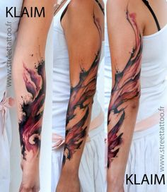 Artistic swirls of paint climb this girls arm in this watercolor fantasy tattoo by French arist KLAIM