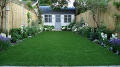 artificial easy grass lawn summer house sandstone paving and white flower planting scheme (1)