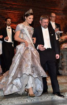 Crown Princess Victoria of Sweden stands for her anthem before the Nobel Prizes in medicine, economics, physics and chemistry were awarded. The Crow Princess was a picture of elegance in her mauve and gold ball gown, beautifully accessorized with glittering jewels, a pearl necklace and a diamond clutch
