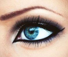 black eyeliner on water line, black and brown smokey eye, white highlight in corner #eyeshadow #blueeyes