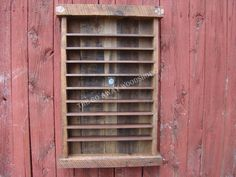 Barnwood display - could be a shot glass rack for a bar area. Or a classic Coca-Cola wooden crate.